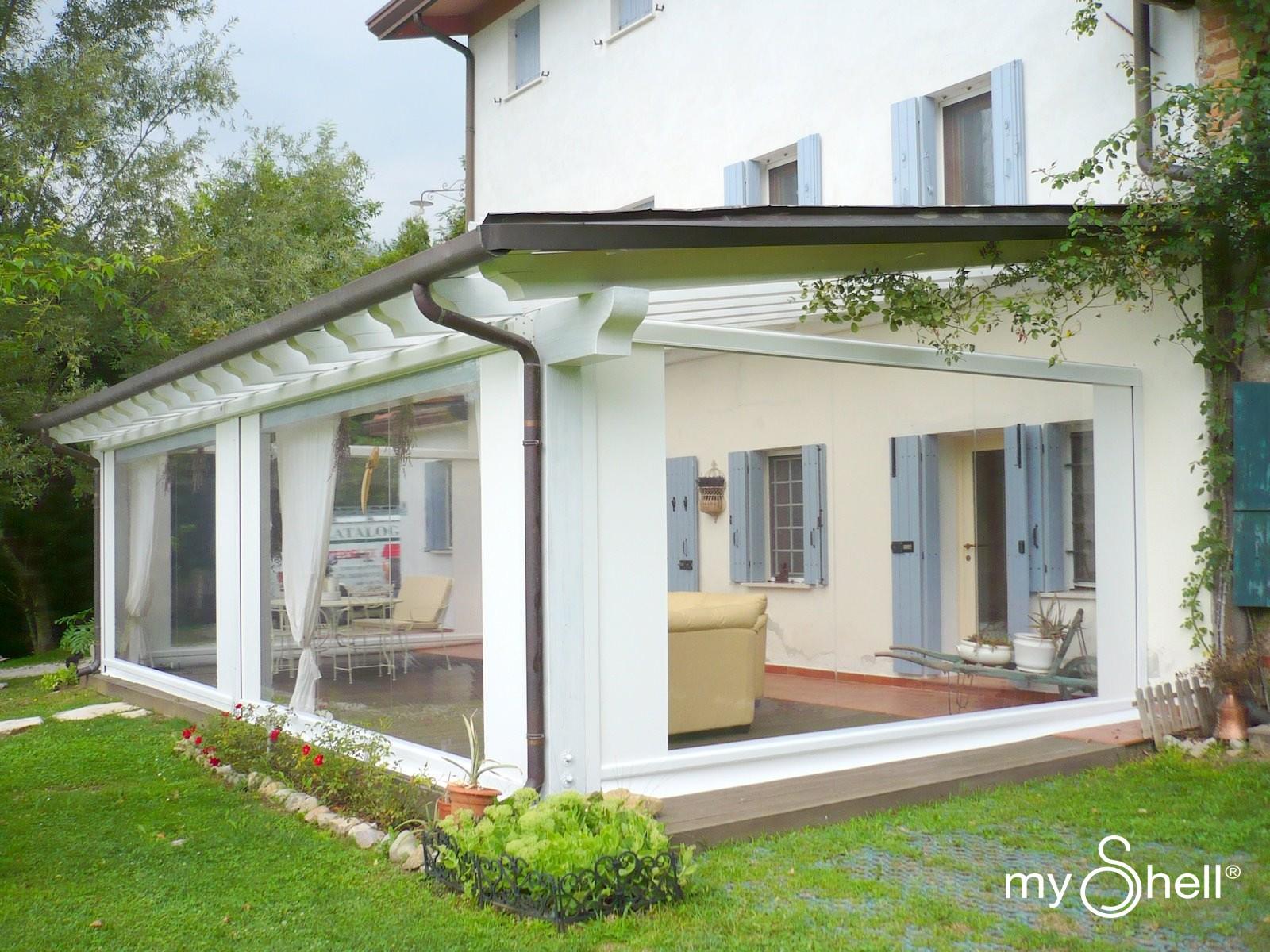 Tende per veranda esterna prezzi idee di design nella for Idee di veranda laterale